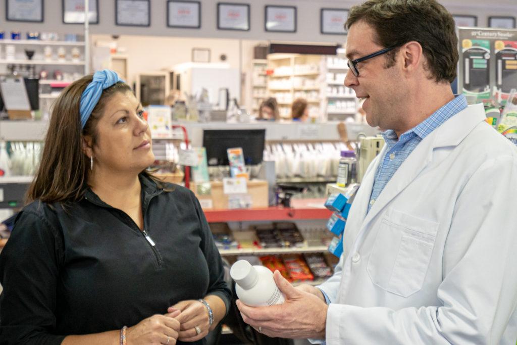 drug store calabash, nc, image of Ed Thomas, PharmD, RPh and customer being served